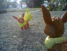 Eevee incounters a flareon by victoriavaporeon