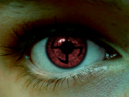 Mangekyou Sharingan by DarkAngelAmv