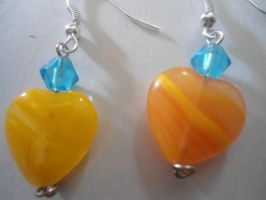 Turquoise and Orange Heart Earrings by depraved-reality