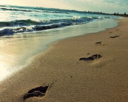 Foot steps on the Beach by SilverSoul1496