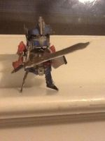 Optimus prime with starsaber by Lilscotty