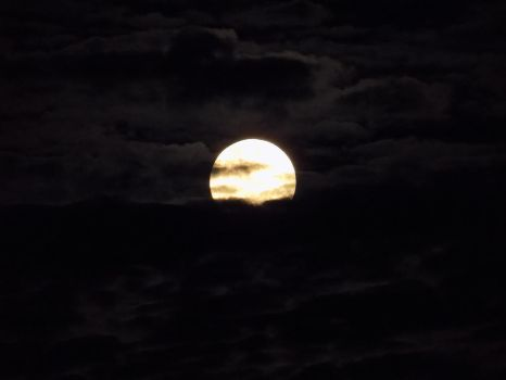 Moon in the Clouds by GeoGenetics