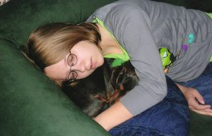 cuddling with a puppy by leapoldsgirlfriend
