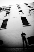 Man and Building by kuniophoto