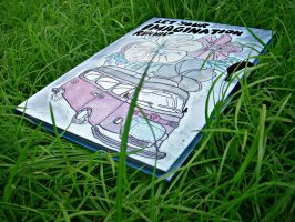 Sketchbook on the grass by Kalayde