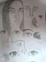 doodling eyes, hair, noses, and hair by DorkaliciousRisa