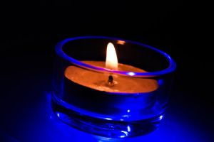 blue lighted candle by KiddPaul