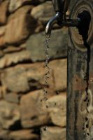 Water Droplets from Tap by drebr