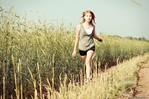 Running in the rye field by Sulde