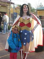 Wonder Woman and a little fan by Wiccanslyr