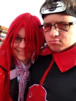 Itachi and Grell by mirageant