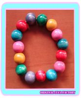 colorful wood bracelet by cuca-factory
