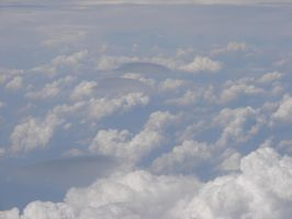 Airplane Above Puffy Clouds 04 by FantasyStock