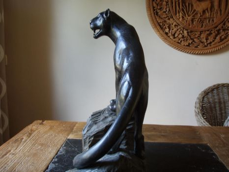 Woodcarver Black panther in bog oak by woodcarve