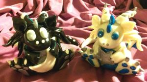 Baby Moon Dragon with Baby Star Dragon by CelestialCreatures