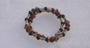 Carnelian, Black, and Gold Coil Bracelet Closeup 4 by Windthin