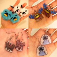 Plastic+plush monster earrings by loveandasandwich