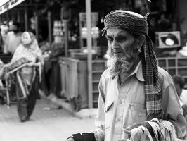 Old Man At The Market - II by InayatShah