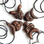 Wooden masks - necklaces by AmberSculpture