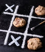 Chocolate chip cookies on noughts and crosses grid by BeKaphoto