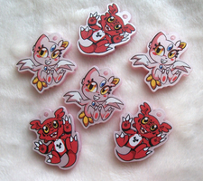 Sneasel and Guilmon acrylic charms by Mesmeromania