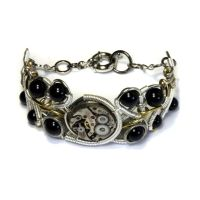 Steampunk Bracelet watch movement and black onyx by CatherinetteRings