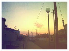 sunset and streetlights. by kitleen