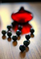 Red vase and marbles... by oyatt