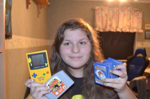 Me with my Pokemon merch. by Reiinzz