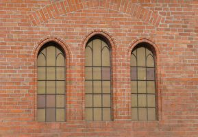 windows in a brick wall by indeed-stock