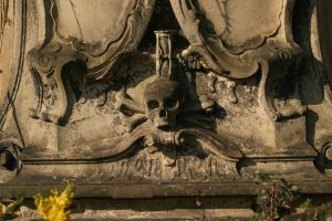 Skull with hourglass on a tomb by almudena-stock