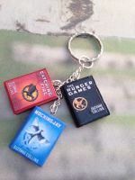 The Hunger Games trilogy book keychain/bracelet by InsaneJellyBean95