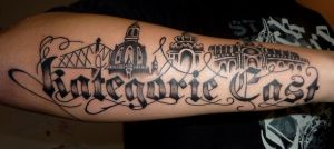lettering and skyline tattoo by D3adFrog