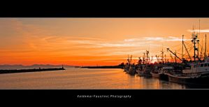 Fishing Boats at Sunset II by Val-Faustino