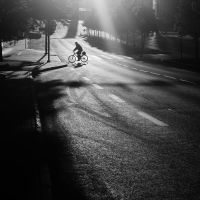 cyclist in the morning sun by dzorma