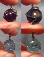 Old Wrapped Materia Pendants by wickedorin