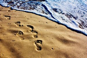 footprints in the sand by SaphoPhotographics