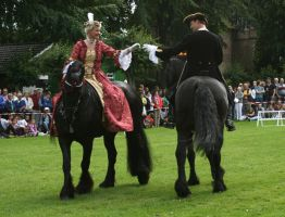 baroque couple on friesian horses by Nexu4