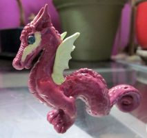 Little pink and green dragon by carmendee