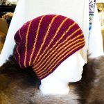 Burgundy and gold shortrow garter stitch hat by KnitLizzy