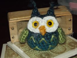Blue and green owlet with yellow eyes by Amigurumi-Lover