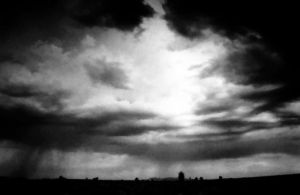 Sunlight through Mohave Storm by mastercylinder