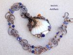 Wire wrapped seashell pendant by IanirasArtifacts
