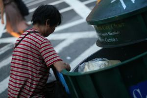 Emptying the Garbage by Assemblitphoto