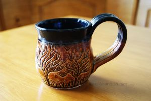 Ceramic Brown and Black Tree Themed Mug by pixelboundstudios
