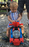 Cody Climbs Aboard Thomas the Train IMG 1369 by WDWParksGal