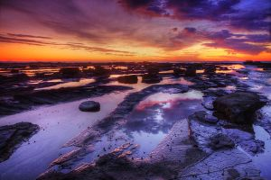 Flat rock exposed at low tide by Kounelli1