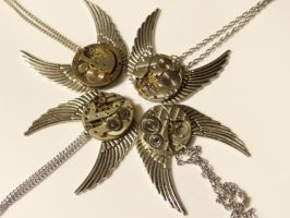 Steampunk snowflake winged necklaces by Hiddendemon-666