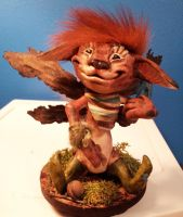Red headed fairy sculpture holding a crystal by twyliteskyz