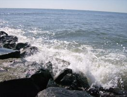 Waves Crash on the Rock Jetty by RustyFanatic05